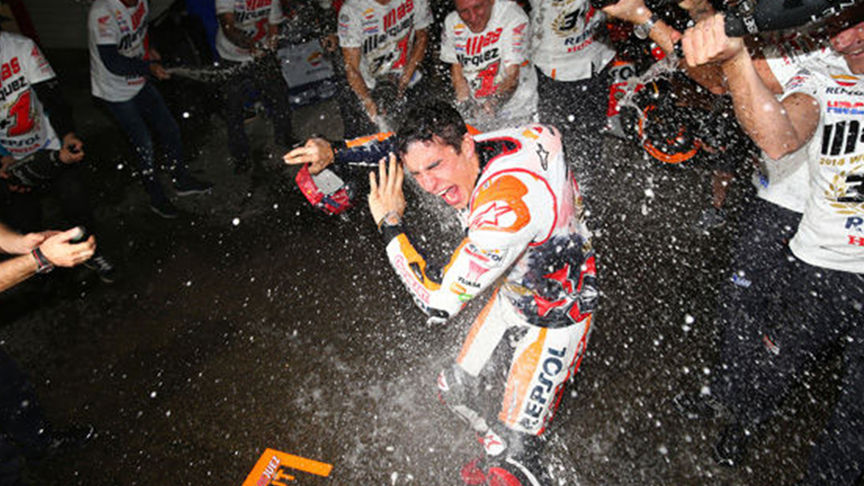rider being sprayed with champagne
